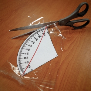 7. Cut out the excess tape as closely to the edge as possible.